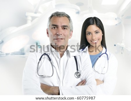 expertise gray hair doctor beautiful nurse in hospital white corridor [Photo Illustration]