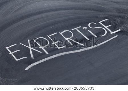expertise word in white chalk handwriting on blackboard
