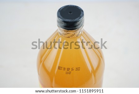 expire date printed on bottle and bottle cap with safety seal