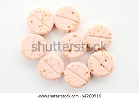 Expired Tablets on white paper. It can not use now. - stock photo