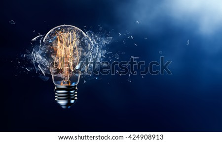 Exploding light bulb on a blue background - 3D Rendering