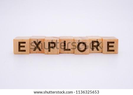 Explore Word Written In Wooden Cube