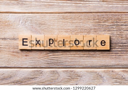 Explore word written on wood block. Explore text on wooden table for your desing, concept. #1299220627