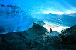 Explorer Inside Ice Cave, Mendenhall Glacier, Juneau, Alaska, USA