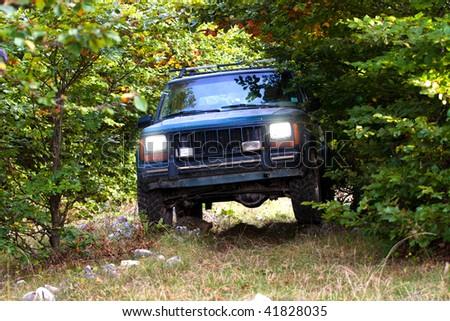 Exploring wilderness on 4x4 vehicle