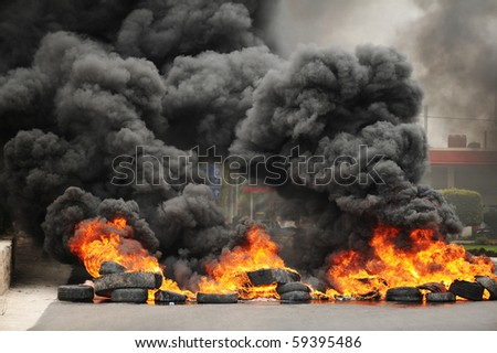 stock-photo-explosion-and-burning-wheels-causing-huge-dark-smoke-and-pollution-59395486.jpg