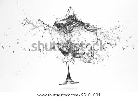 Explosion of a glass with water on a white background