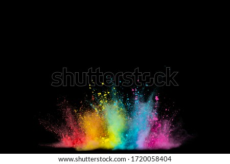 Explosion of colored powder isolated on black background. Abstract colored background Foto stock ©