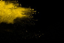 Explosion of colored powder, isolated on black background. Power and art concept, abstract blast of colors.