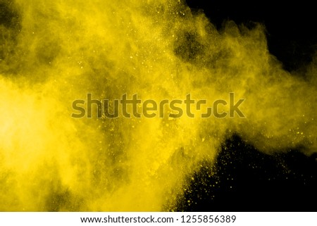 Explosion of colored powder, isolated on black background. Power and art concept, abstract blast of colors. #1255856389
