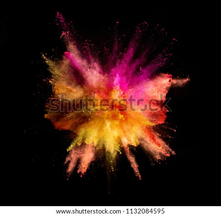 Explosion of coloured powder isolated on black background #1132084595