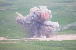 Explosion of military explosives in the open