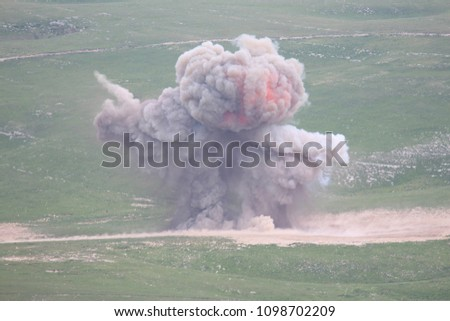 Explosion of military explosives in the open #1098702209