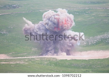 Explosion of military explosives in the open #1098702212