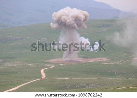 Explosion of military explosives in the open #1098702242