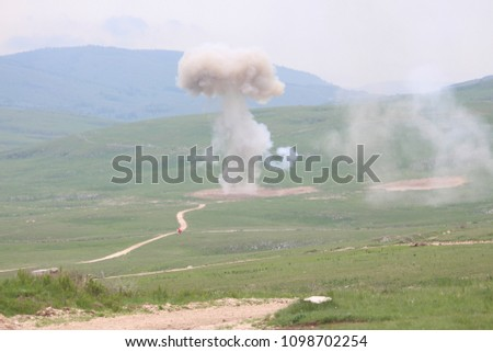 Explosion of military explosives in the open #1098702254