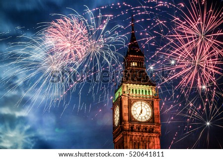 Explosive fireworks display fills the sky around Big Ben. New Year's Eve celebration background #520641811
