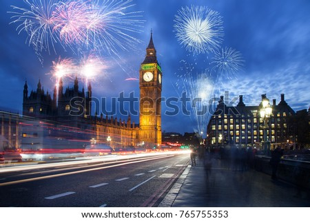 explosive fireworks display fills the sky around Big Ben. New Year's Eve celebration in the city #765755353