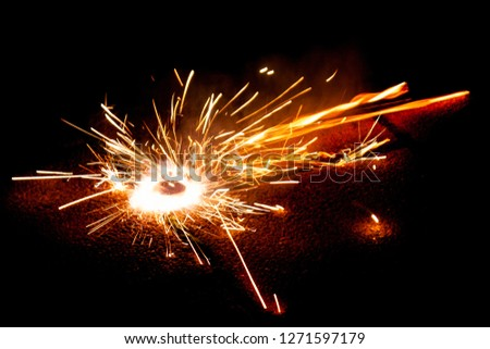 Explosive fireworks on sylvester lightens in the dark with sparks of light #1271597179