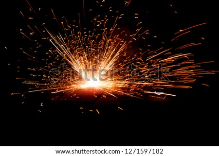 Explosive fireworks on sylvester lightens in the dark with sparks of light #1271597182