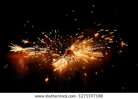 Explosive fireworks on sylvester lightens in the dark with sparks of light #1271597188