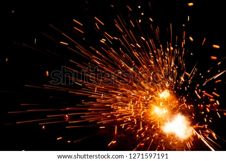 Explosive fireworks on sylvester lightens in the dark with sparks of light #1271597191