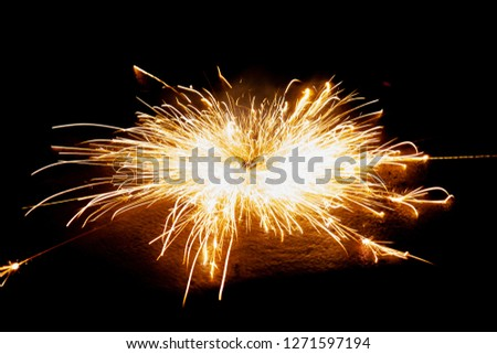 Explosive fireworks on sylvester lightens in the dark with sparks of light #1271597194