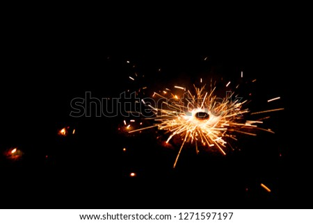 Explosive fireworks on sylvester lightens in the dark with sparks of light #1271597197