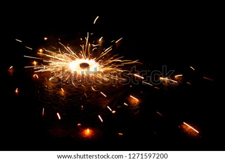 Explosive fireworks on sylvester lightens in the dark with sparks of light #1271597200