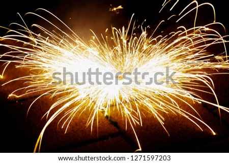 Explosive fireworks on sylvester lightens in the dark with sparks of light #1271597203