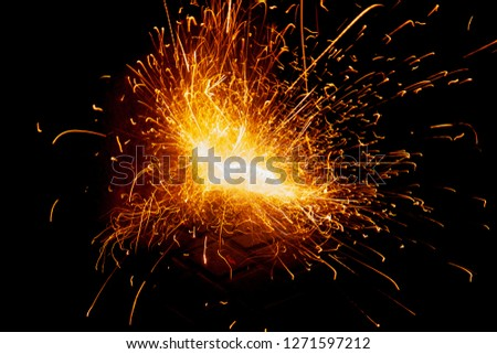 Explosive fireworks on sylvester lightens in the dark with sparks of light #1271597212
