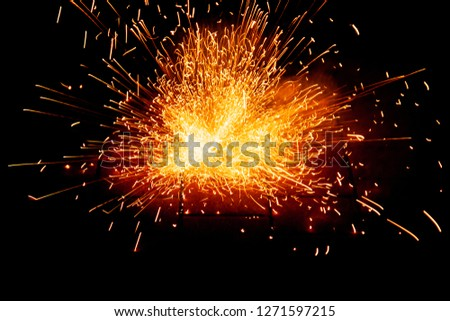 Explosive fireworks on sylvester lightens in the dark with sparks of light #1271597215