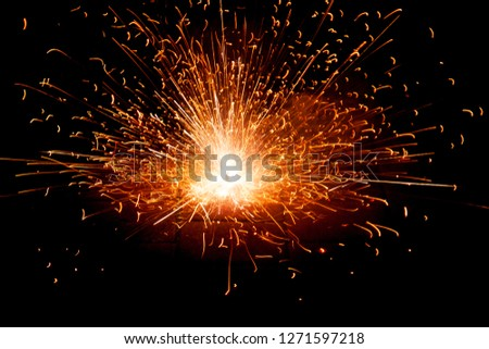 Explosive fireworks on sylvester lightens in the dark with sparks of light #1271597218