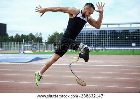 Explosive start of athlete with handicap at the stadium Foto stock ©