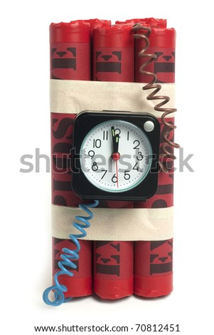 Explosive with alarm clock fuse, isolated on white background