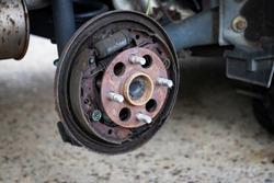 Exposed car brakes during brake pads job