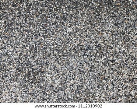 Exposed concrete floor made of small loose pebbles in light gray color shades. #1112010902