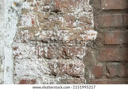 exposed cracked brick wall  #1151995217