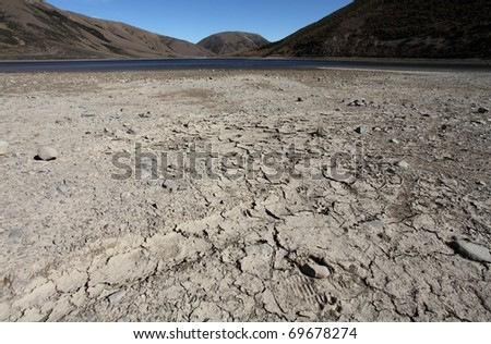 Exposed lake bed in the high country of New Zealand after a dry summer period