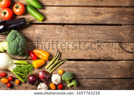 Exposition of fresh organic vegetables on wooden table. tomato, pepper, broccoli, onion, garlic, cucumber,  eggplant, black Eyed Peas