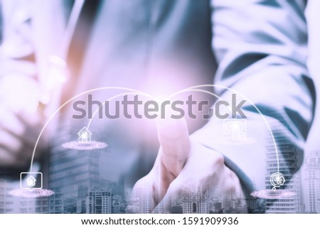 Exposure businessman consultant with modern virtual technology and blurred hand holding golden key, The key factor is like the person who gives important about the business advice concept.