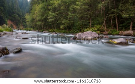 Exposure picture of water running down the McCloud River in America, Northern California