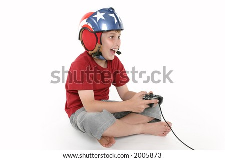 Expression of joy as a boy plays a simulator game. Space for text.