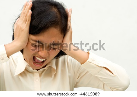 expression of stressful asian businesswoman on crisis. hands on head