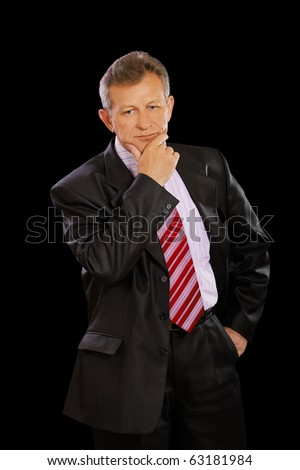 expression portrait of thinking senior businessman in suit on black