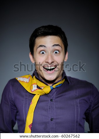 Expressions Handsome business man in funny shirt and tie surprise and laughing
