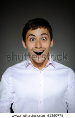 Expressions Handsome business man in funny shirt and tie surprise and laughing with open mouth