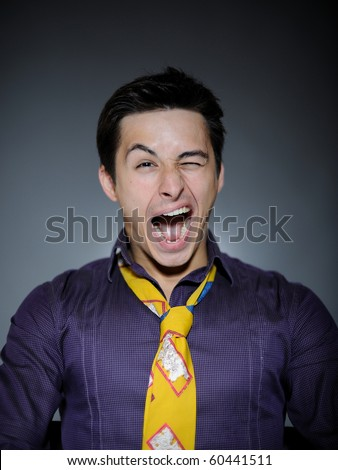 Expressions Handsome man in funny shirt and tie laughing and wink