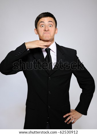 expressions - young tired business man. gray background