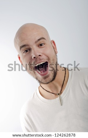 Expressive bald man on a blue background